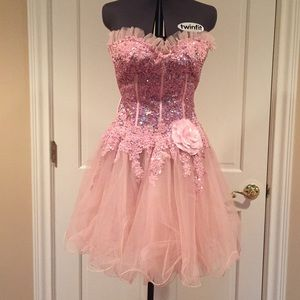 Pink beaded party dress perfect for a Sweet 16.